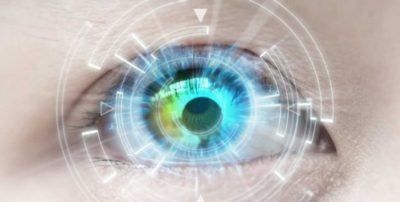 image displaying a human eye with a hologram projected above it to represent augmented reality, AR