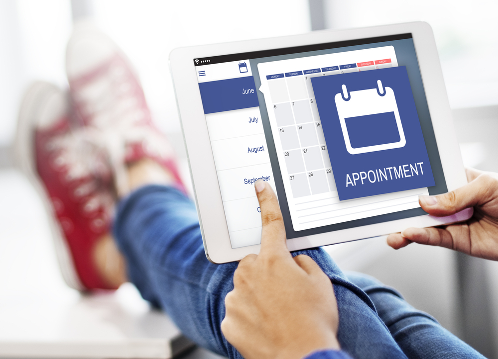 A person booking an appointment from their tablet
